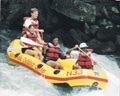 Rafting passengers ride Class III Nantahala Falls. Copyright NOC. Used with permission.