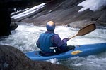 Roger Derrough in his kayak paddling Ten Foot Falls, Wilson Creek Gorge (NC).  Copyright Chris Bell.