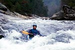 Roger Derrough in his kayak paddling Wilson Creek Gorge (NC).  Copyright Chris Bell.