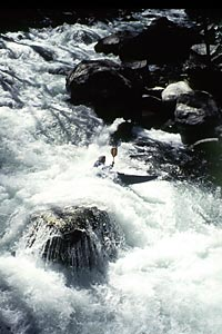 Big Fun, Rapid upstream of bridge, Philip Curry, Upper Big Creek (NC).  Copyright Chris Bell.