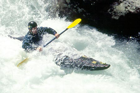 Greg in Action, Rapid upstream of bridge, Greg Merchen, Upper Big Creek (NC).  Copyright Chris Bell.