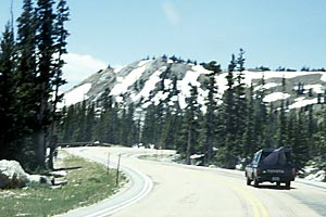 Driving to the Encampment, Snowy Range Pass, Medicine Bow Mountains (WY).  Copyright Chris Bell.