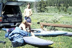 Loading Camping Gear, Put-in parking area, Philip Curry and Edward Chapman , Encampment (WY).  Copyright Chris Bell.
