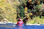 Unknown boater in his kayak paddling downstream from the Garden Hole put-in-take-out, Russell Fork (VA-KY).  Copyright Chris Bell.