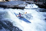 Chris Bell in his kayak paddling Sock 'em Dog, Section 4 of the Chattooga (GA-SC).  Copyright Unknown.