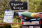 Photograph of boats in the back of a pick up truck in front of a Tapoco Lodge sign Cheoah (NC).  Copyright Chris Bell.