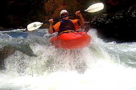 Steve Heisleman in his kayak paddling the Upper Gauley (WV).  Copyright Chris Bell.