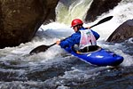 Tommy Hilleke in his kayak racing through Frankenstein, Green Narrows (NC).  Copyright Chris Bell.