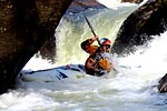 Pat Keller in his kayak racing through Frankenstein, Green Narrows (NC).  Copyright Chris Bell.