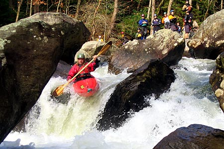 Chris Harjes in his kayak racing through Frankenstein, Green Narrows (NC).  Copyright Chris Bell