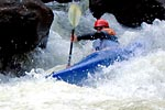 David Jacobsen (DJ) in his kayak racing through Pin Cushion, Green Narrows (NC).  Copyright Chris Bell.