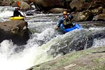 Unknown boater in his kayak racing through Reverse Seven Foot Falls, Green Narrows (NC).  Copyright Chris Bell.