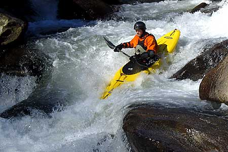 Alex in his kayak paddling the Lower Rocky Broad (NC).  Copyright Chris Bell.